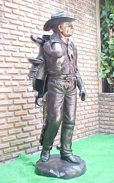 Bronze Cowboy Saddle Statue